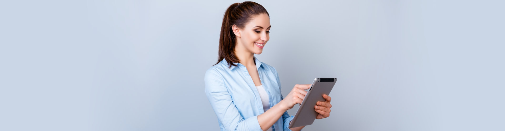 woman using tablet